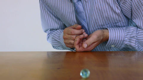 Businessman Shoots Marble Quality Stock Video Footage