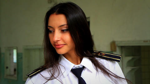 Beautiful girl posing for the camera in clothing cadet. 4 Stock Video Footage
