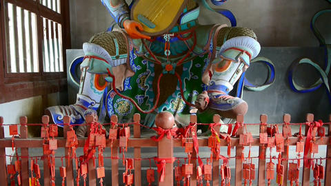 Chinese immortals Buddhist Vajra sculpture holding a pipa... Stock Video Footage