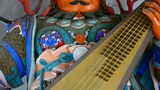 Chinese immortals Buddhist Vajra sculpture holding a pipa lute instruments in carved beams painted b Footage