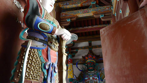 Chinese immortals Buddhist samurai Vajra sculpture in carved beams painted buildings,ancient door Footage