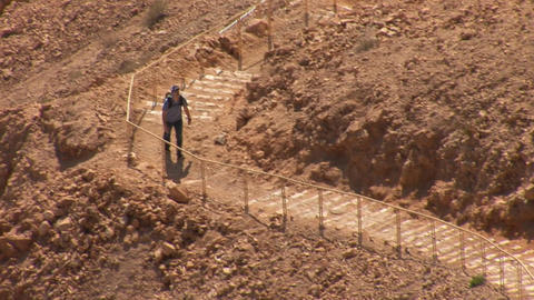 Climbing the stairs to the fortress Masada Stock Video Footage