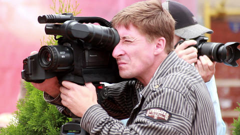 Photographer at work 1 Stock Video Footage