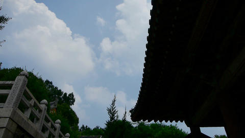 High clouds and temple roof,flowing clouds Stock Video Footage