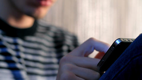young adult man using touchscreen phone Stock Video Footage