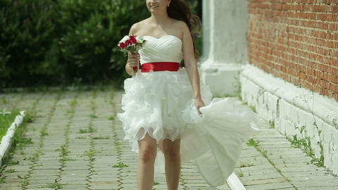 Bride in the short wedding dress with bouquet Footage