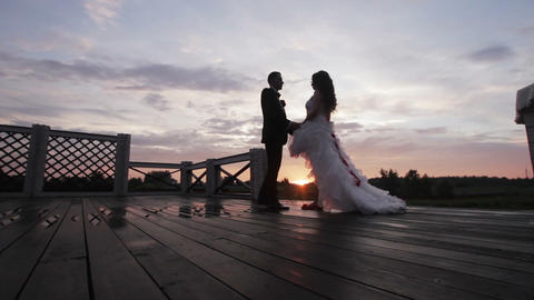 Wedding couple holding hand on sunset Footage
