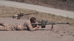 Marine scout snipers practice their marksmanship skills with a 50 cal rifle Footage
