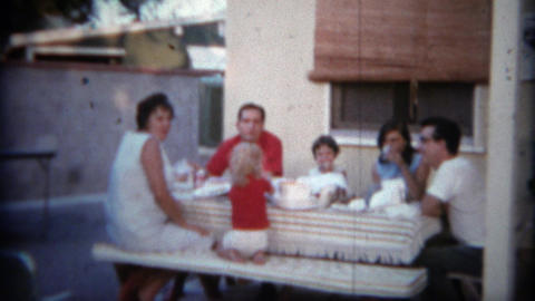 1966: Family enjoying the backyard patio picnic table with lunch. SAN DIEGO, CAL Footage
