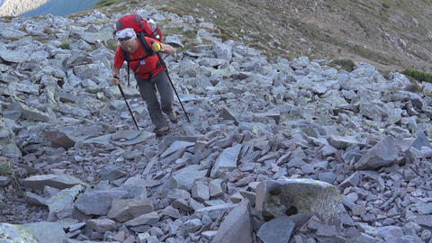 Tripper With Ruxac In Back Climb A Slope Full Of Boulders 17b stock footage