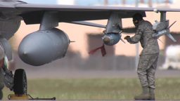 Ground Crew checking bombs on aircraft Footage