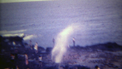 1973: Ocean blowhole surprise water spray from strong wave action. HONOLULU, HAW Footage