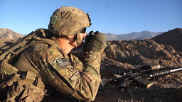 U.S. infantry soldier observing enemy through binoculars Footage