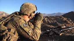 U.S. infantry soldier observing enemy through binoculars Footage