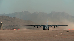 C-130 Hercules blows up dust as it gets ready to takeoff Footage