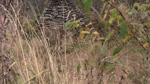 Stone Crucifix Seen Through Thick And Dry Grass At Side Of The Road 58b stock footage
