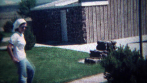 1972: Religious teenager visits interstate rest stop keep dogs on leash sign. MA Footage