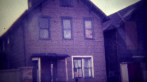 1971: Abandoned and boarded up homes start as people move out of the rust belt.  Footage