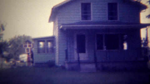 1971: American farmhouse with 3 vehicles parked in the driveway. DES MOINES, IOW Footage