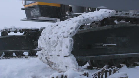 Caterpillar Track of Machinery Moves in Snow Footage
