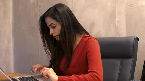 Young businesswoman working on her computer in office Footage
