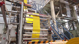 Plastic bags production line with yellow sheet Footage