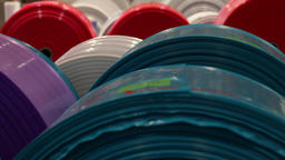 Rolls of plastic sheeting in various colors Footage