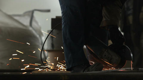 Man Works with Electric Angle Grinder Footage