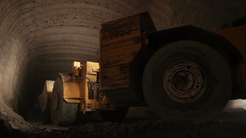 Mining Machinery Moves in Limestone Mine Footage