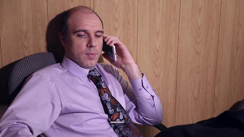 Office worker is talking on the mobile phone Footage