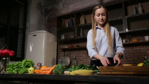 Young woman cooking healthy smoothie in kitchen Footage