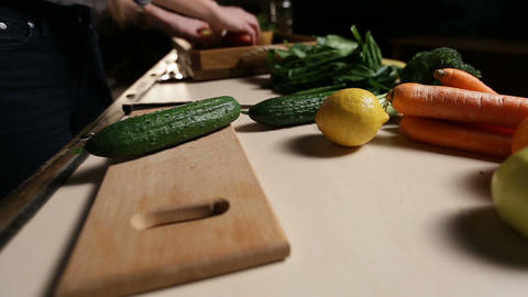 Organic fresh cucumber on wooden chopping board Footage