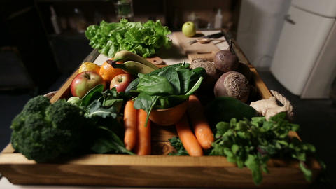 Set of fresh vegetables and fruits on wooden tray Footage