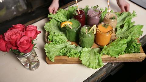 Smoothies of various colors and tastes in jars Footage
