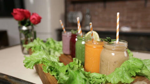 Tray with assortment of smoothies in jars Footage