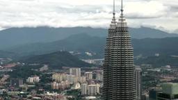 Malaysia Kuala Lumpur 024HD tops of petronas towers and mountains Footage