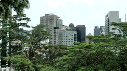 Malaysia Kuala Lumpur 027 office buildings, homes and trees Footage