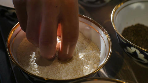 Closeup Cook Hand Touches Flour by Fingers in Bowl Footage