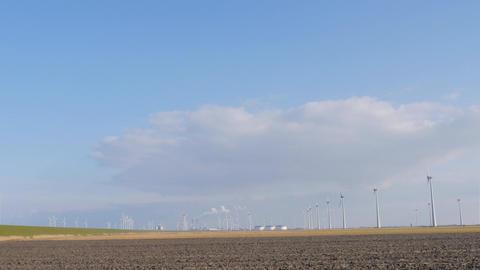 Windmill turbine park near levee Footage