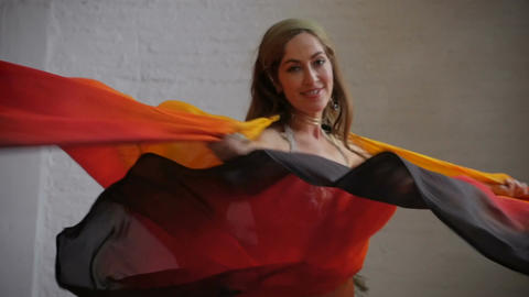 A beautiful female performer dancing and twirling with colorful wings smiling an Footage