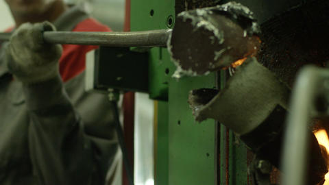 Worker Pours Hot Liquid Glass into Special Oven Footage
