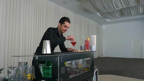 Bartender serving cocktail drink in slow motion at a bar Footage