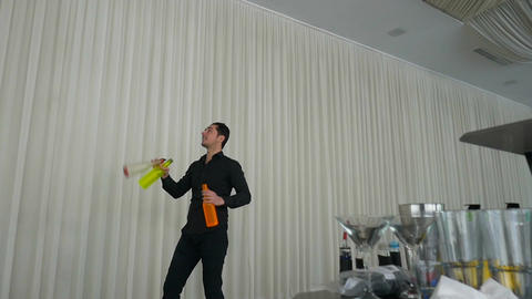 Entertainer performing show using flair bartending techniques Footage