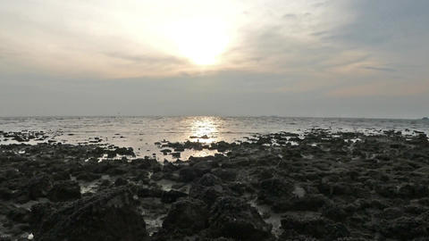 Amazing sunset view at the beach with rocks silhouette foreground Footage