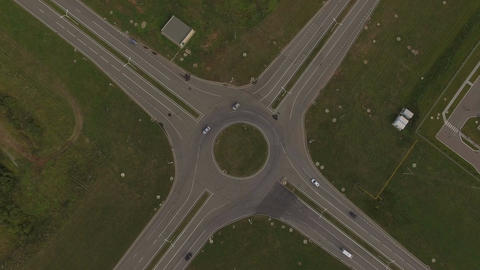 Aerial View Crossroad Cars Move Around Circle Footage