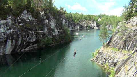 People flying on a zip line Footage