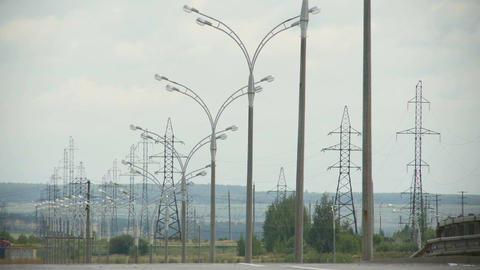 High Voltage Lines and Streetlights on Road Side Footage