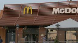 4K Ungraded: People Come and Go in Door of Restaurant McDonald's Summer Footage