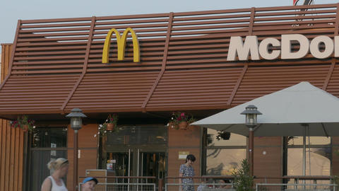 4K Ungraded: People Come and Go in Door of Restaurant McDonald's Summer Footage