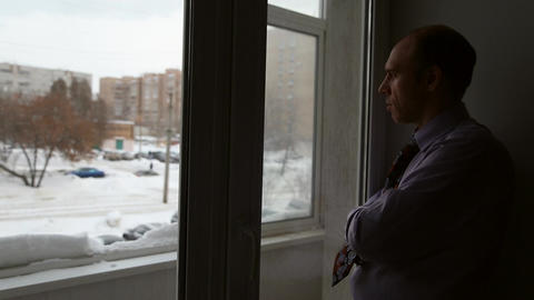A man stands near window Live Action